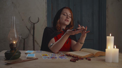Sorceress fortune telling with runic stones indoor Live Action
