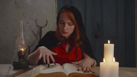 Portrait of mysterious sorceress with magic book Live Action