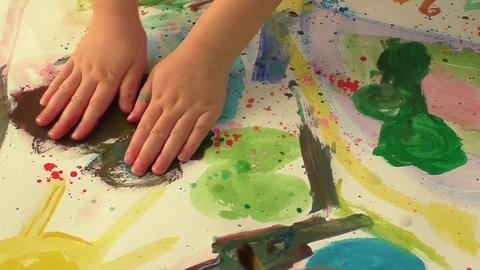 Creative paint art with little hand of a young girl. Childhood and education the Filmmaterial