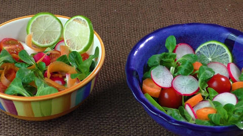 Bowl of fresh vegetable salad on jute table cloth. Cold cuts. Healthy food Live Action