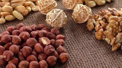 Almonds, cashew, walnuts and hazelnuts lying on burlap Live Action