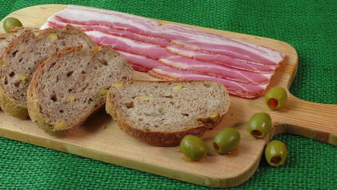 Cutting board with bacon and bread. Cold cuts Live Action