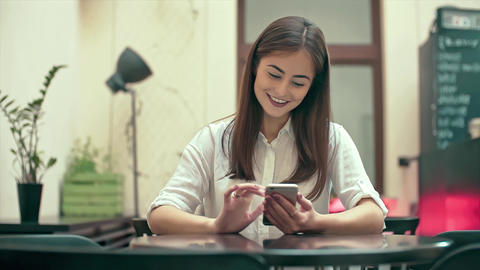 Woman Using App on Smartphone in Cafe Slow Motion Footage