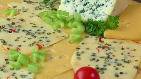 Variety of cheeses on a wooden board. Healthy food. Cold appetizer. Cold cuts ライブ動画