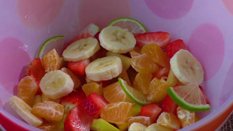 Bowl of healthy colorful fruit salad. Healthy breakfast. Healthy food Live Action