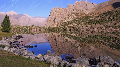 Moonlight over a lake. Traces of stars similar to metory. Time Lapse. Pamir, Taj Footage