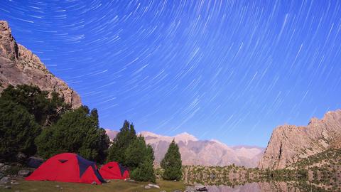 Moon illuminates the mountains. Traces of stars similar to metory. TimeLapse. Pa Footage