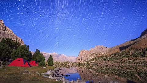 Stars reflected in the lake. Traces of stars similar to metory. TimeLapse. Pamir Footage