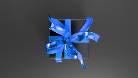 Elegant black gift box with blue ribbon opening. Top view 動畫