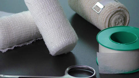 Medical bandages with scissors and sticking plaster Footage