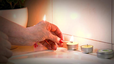 Lighting Candles For A Salt Bath Footage