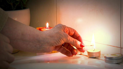 Lighting Candles For A Salt Bath Footage