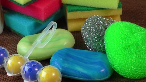 Container with liquid for glass, soap, colorful sponges for washing Footage