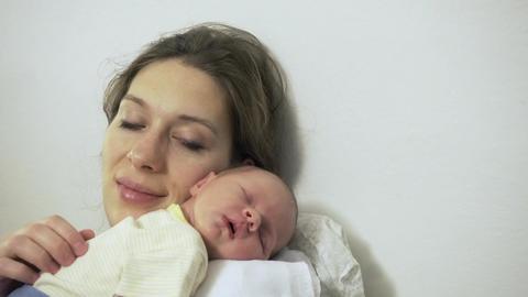 Mother Stroking Newborn Baby Sleeping Closeup Shoulder Footage