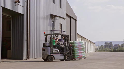 Man on a Forklift Goes Out with Large Warehouse Footage