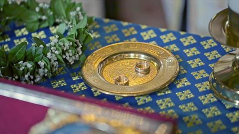 Wedding Rings on Ceremony in the Church Table Footage