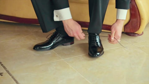 Business Man Tying Shoe Laces on the Floor Groom Footage