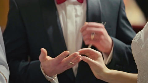 Groom Wears Wedding Ring on Woman's Hand Bride Ceremony Footage