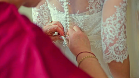 Bridesmaids Helping to Tie Her Wedding dress Footage