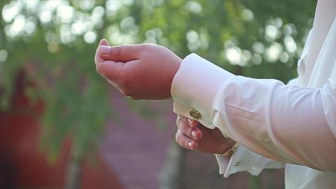 Man Buttons Cufflinks in White Shirt Groom Wedding Footage