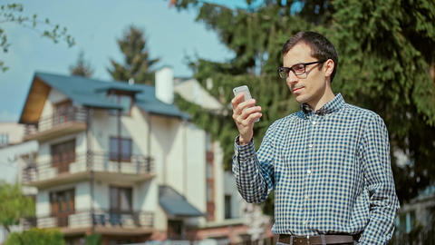 Young Man Holding Mobile Phone Footage