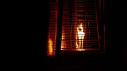 4K Fire Burning Inside Contemporary Metallic Decorative Lamps in Dark Footage