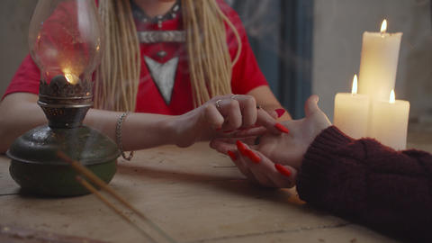 Soothsayer giving good luck charm to woman Live Action