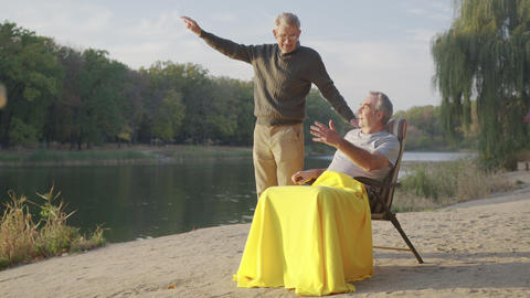 Active retirement with group of happy old male friends talking. Lifestyle for Live Action