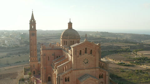Beautiful Sand Brown Colored Church in Countryside of Gozo, Malta in beautiful Live Action