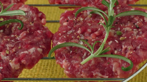 Raw minced hamburger meat with herb and spice prepared for grilling Footage
