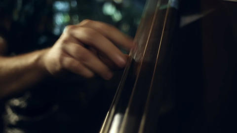 The musician plays jazz music on the cello GIF