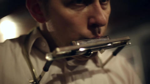 Musician plays the harmonica Footage