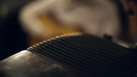 Musician plays the accordion Footage