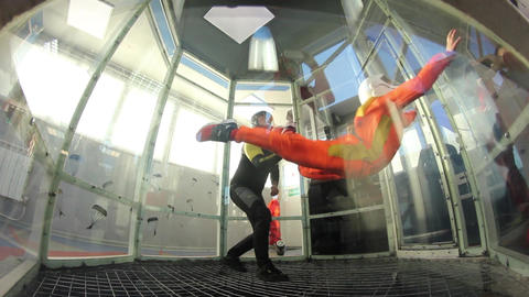 Girl learning to fly in aero tube Footage