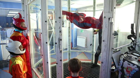 Boy learning to fly in aero tube Footage