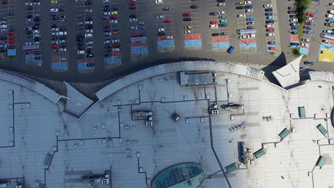 Supermarket roof and many cars in parking, viewed from above Footage