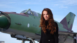 Optimistic woman portrait, lady stand against museum military airplane Footage