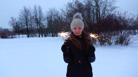 Merry woman with two bengal lights pose at snowbound park, slow motion shot Footage