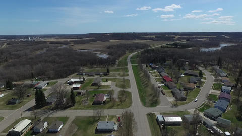 Aerial drone flying over small road in small town rural USA near a river Live Action