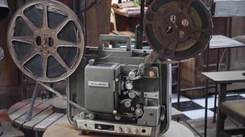 Old film projector with film Live Action
