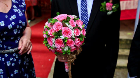 Groom Holds Wedding Bouquet of Pink Roses Footage