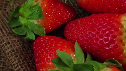 Ripe juicy strawberries on jute sackcloth Footage