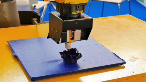 The robot performs 3D printing Footage
