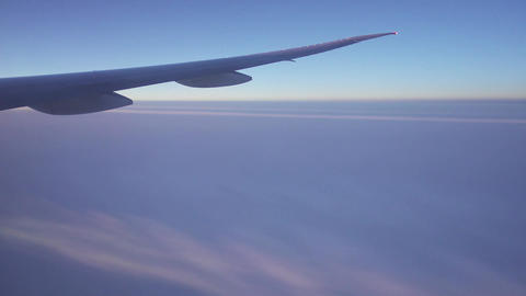 looking on wing and fumes of flying airplane, 4k Footage