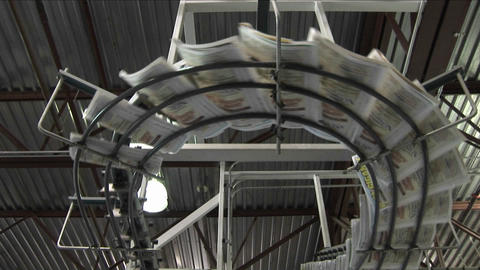 Newspapers flow along an assembly line in a newspaper... Stock Video Footage