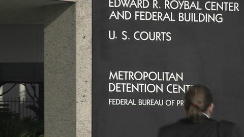 A zoom back from a Federal Detention Center in Los Angeles Stock Video Footage