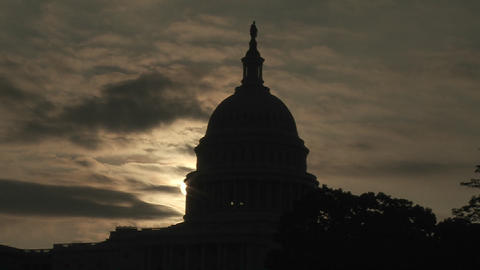 Clouds move behind the U.S. Capitol Building in Washington DC Footage