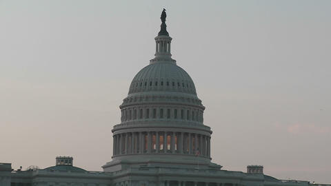 Zoom back from the Capitol Building at dusk Footage