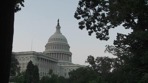 A zoom into the Capitol Building in Washington DC at dusk Footage