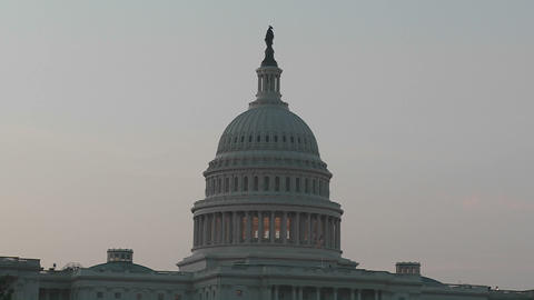 A zoom into the Capitol Building in Washington DC at dusk Stock Video Footage